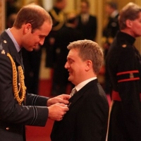Aled receiving his MBE from Prince William.